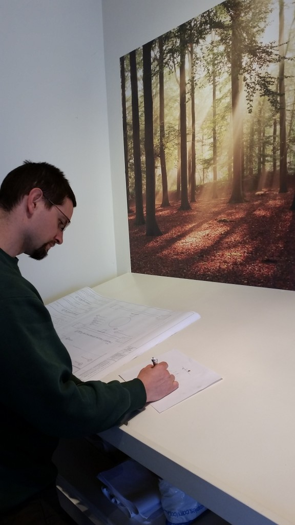Dan designing a leaf platform for one of Treehouse World's themed tree houses!